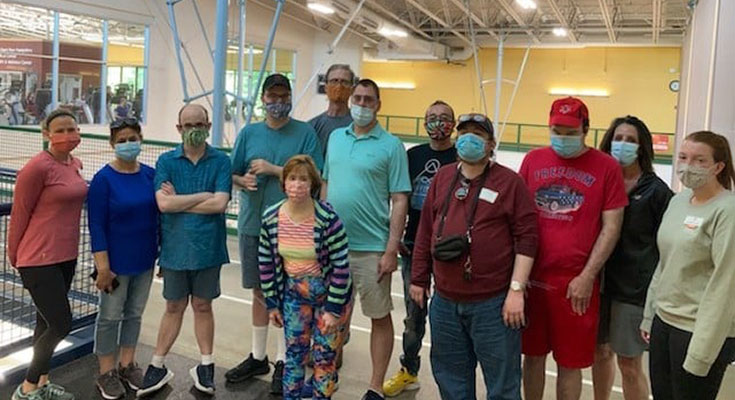 Group of PLUS company workers